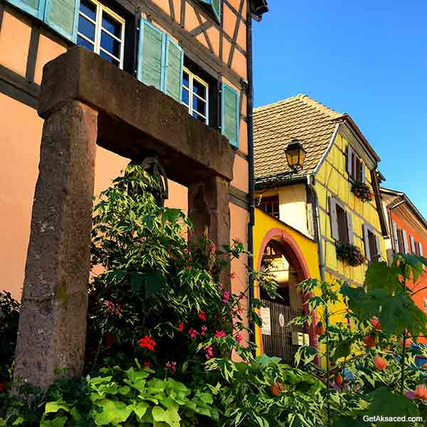 Alsace village well and flowers in France